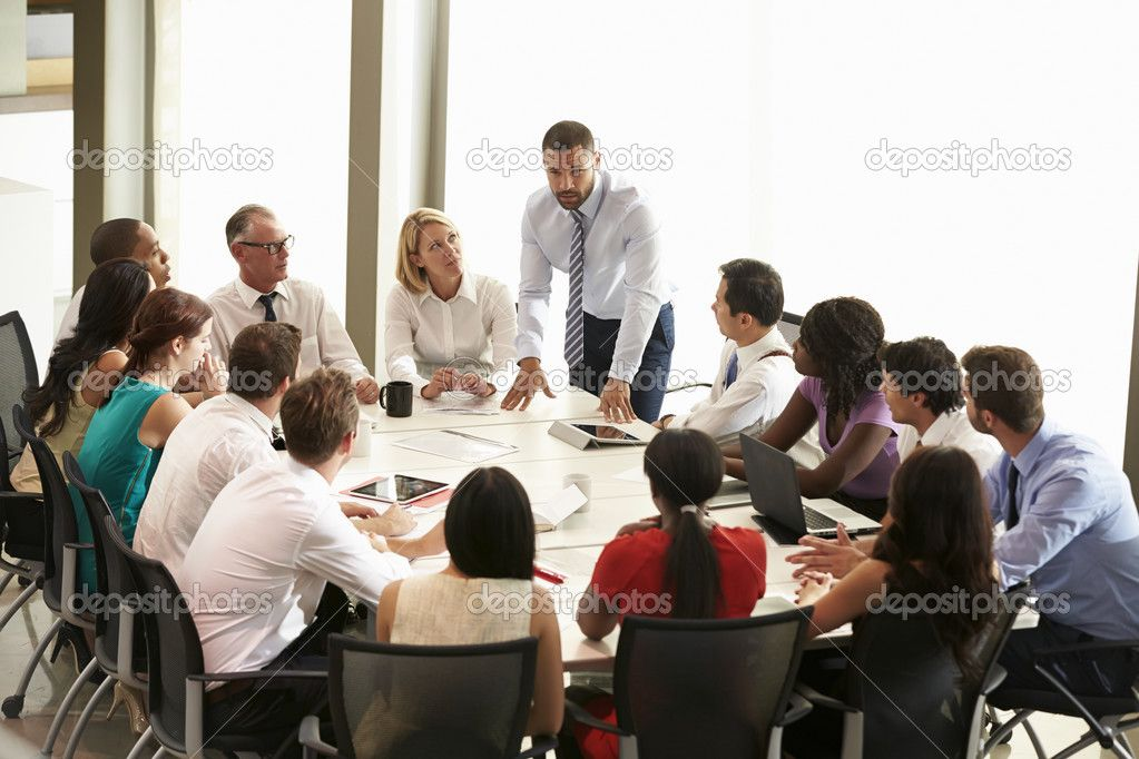 depositphotos_48459951-Businessman-Addressing-Meeting-Around-Boardroom-Table